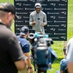 Cam Newton works to speed up his decision making in the New England offense