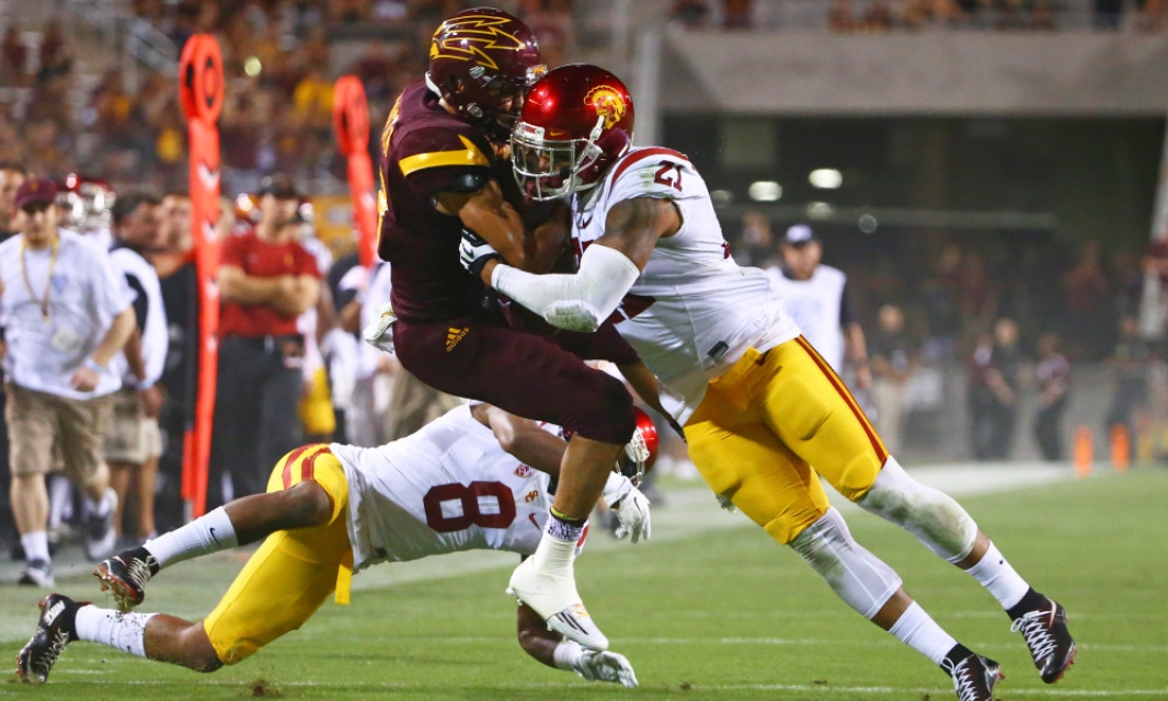 Sep 26, 2015; Tempe, AZ, USA; Arizona State Sun Devils wide receiver D.J. Foster (left) is tackled by Southern California Trojans linebacker Su'a Cravens at Sun Devil Stadium. Mandatory Credit: Mark J. Rebilas-USA TODAY Sports