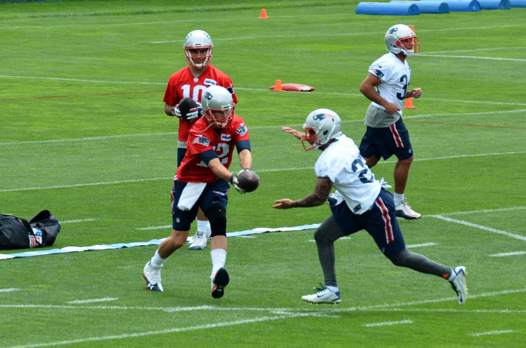 "Foster takes a handoff inside the ""triangle"" from Tom Brady"